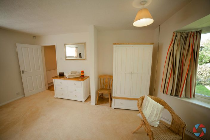 The Cottage Needingworth - master bedroom with storage